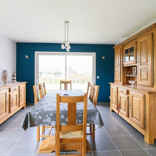Danish slate floor and gray floor dining room photo in Grenoble with blue walls