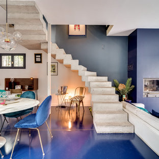 Foto de comedor minimalista, de tamaño medio, con chimenea tradicional y suelo azul