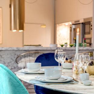 Imagen de comedor minimalista, de tamaño medio, con chimenea tradicional y suelo azul