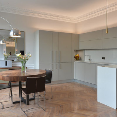 Inspiration for a large contemporary brown floor and light wood floor great room remodel in Paris with white walls
