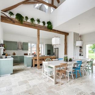 Foto de comedor ecléctico, grande, abierto, con paredes blancas, suelo de mármol, estufa de leña y suelo beige