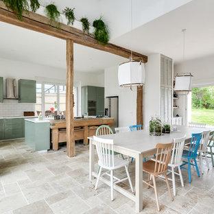 Foto de comedor bohemio, grande, abierto, con paredes blancas, suelo de mármol, estufa de leña y suelo beige