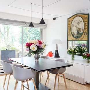 Dining room - small scandinavian light wood floor and beige floor dining room idea in Paris with white walls and no fireplace