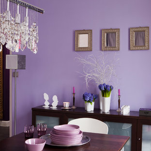 Photo of a contemporary dining room in Paris with purple walls, medium hardwood floors and brown floor.