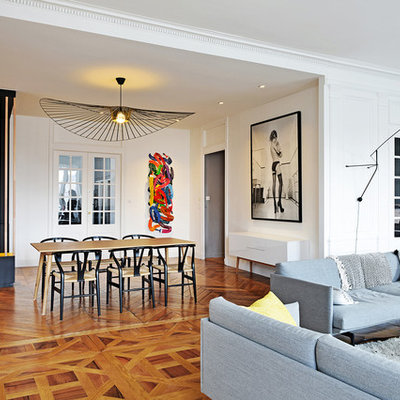 Inspiration for a mid-sized contemporary medium tone wood floor and brown floor great room remodel in Lyon with white walls