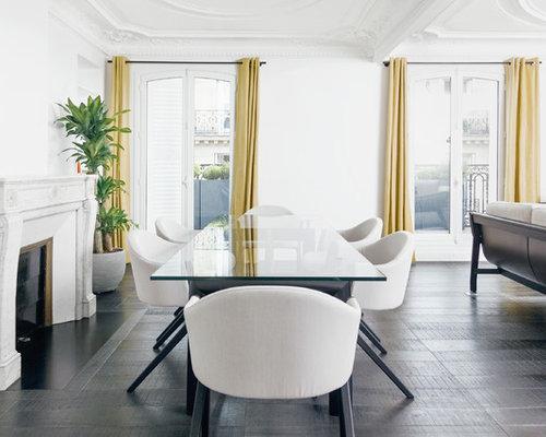 Cette Image Montre Une Salle à Manger Design De Taille Moyenne Avec Un Mur  Blanc,