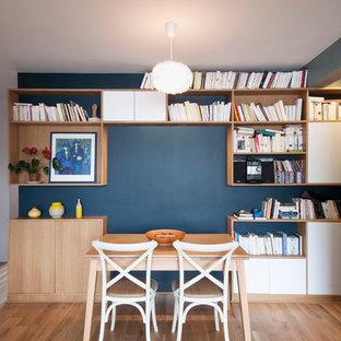 Dining room - small scandinavian light wood floor dining room idea in Paris with blue walls