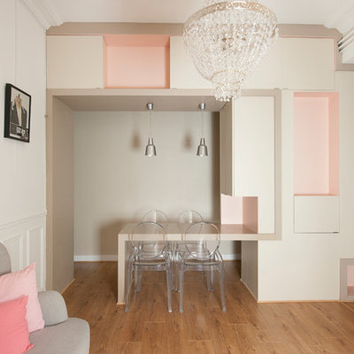 Mid-sized trendy medium tone wood floor great room photo in Paris with white walls and no fireplace