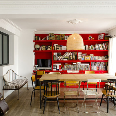 Example of a mid-sized trendy medium tone wood floor great room design in Paris with red walls