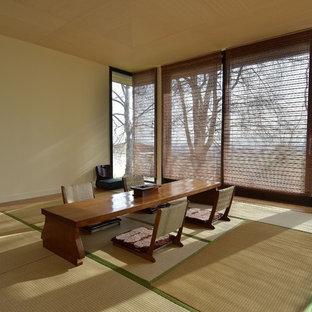 Foto di una grande sala da pranzo etnica con pavimento in tatami