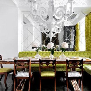 Esempio di una sala da pranzo boho chic chiusa e di medie dimensioni con pareti bianche, parquet scuro e pavimento nero