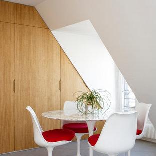 Réalisation d'une salle à manger design de taille moyenne avec un mur blanc, un sol en carrelage de porcelaine et un sol gris.
