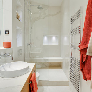 Mid-sized trendy 3/4 marble tile gray floor and double-sink bathroom photo in Paris with beaded inset cabinets, light wood cabinets, a wall-mount toilet, gray walls, a drop-in sink, marble countertops, a hinged shower door, gray countertops and a floating vanity