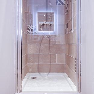 Idee per una piccola stanza da bagno con doccia eclettica con ante a filo, ante marroni, piastrelle marroni, piastrelle di cemento, pareti bianche, pavimento in cementine, lavabo sottopiano, top in superficie solida, pavimento marrone e porta doccia a battente