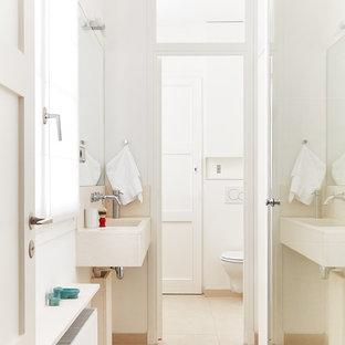Idées déco pour une salle de bain scandinave avec un lavabo suspendu, un carrelage beige et un mur blanc.