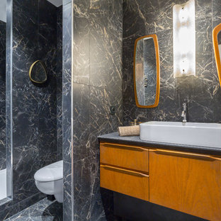 Inspiration for a 1950s 3/4 black and white tile and gray tile black floor bathroom remodel in Lyon with flat-panel cabinets, medium tone wood cabinets, a wall-mount toilet, a vessel sink and gray countertops