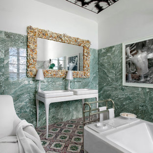 Inspiration for a mediterranean green tile and stone slab freestanding bathtub remodel in Milan with white walls and a console sink