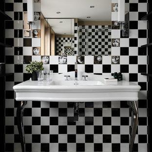 Inspiration pour une salle d'eau design de taille moyenne avec un carrelage noir et blanc et un plan vasque.