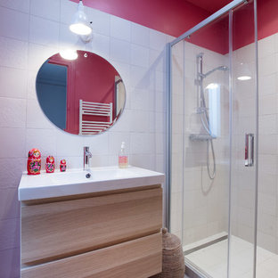 Example of a small trendy master white tile white floor bathroom design in Paris with light wood cabinets, pink walls, flat-panel cabinets and a wall-mount sink