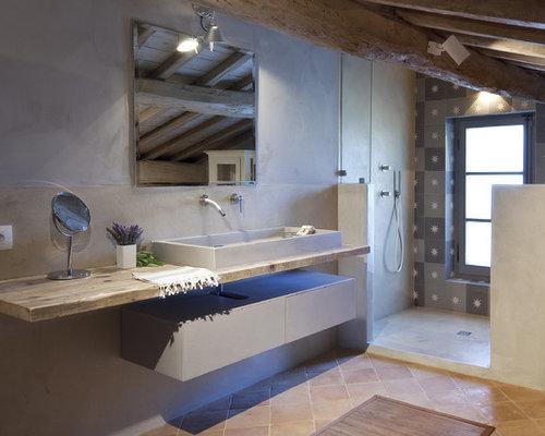 Salle de bain avec un sol en carreau de terre cuite for Un carreau de terre
