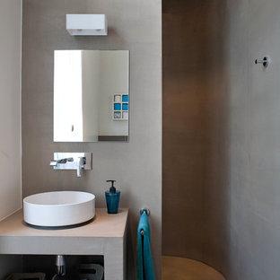 Inspiration pour une petit salle d'eau design avec une vasque, un placard sans porte, une douche ouverte, un mur gris et aucune cabine.