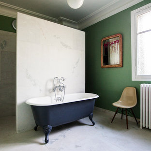 Inspiration for a large contemporary master bathroom in Paris with a claw-foot tub, a curbless shower, white tile and green walls.