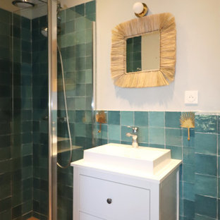 Inspiration for a small mediterranean 3/4 bathroom in Other with white cabinets, a curbless shower, green tile, ceramic tile, beige walls, laminate floors, a drop-in sink, beige floor, an enclosed toilet, a single vanity and a freestanding vanity.