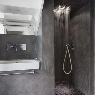 Ejemplo de cuarto de baño con ducha, actual, de tamaño medio, con paredes grises, suelo de cemento, ducha a ras de suelo y lavabo suspendido