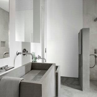 Bathroom - mediterranean concrete floor bathroom idea in Other with white walls