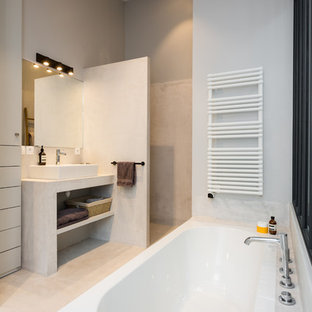 Mid-sized eclectic master gray tile light wood floor and beige floor walk-in shower photo in Paris with white walls, open cabinets, gray cabinets, a two-piece toilet, a vessel sink, concrete countertops and gray countertops