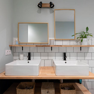 Photo of a small contemporary 3/4 bathroom in Lyon with a freestanding tub, white tile, linoleum floors, a console sink, green floor and a double vanity.