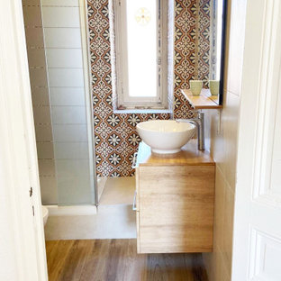 Design ideas for a small mediterranean shower room bathroom in Nice with light wood cabinets, a built-in shower, a one-piece toilet, multi-coloured tiles, cement tiles, beige walls, wood-effect flooring, a built-in sink, wooden worktops, brown floors, an open shower, beige worktops, a single sink and a floating vanity unit.