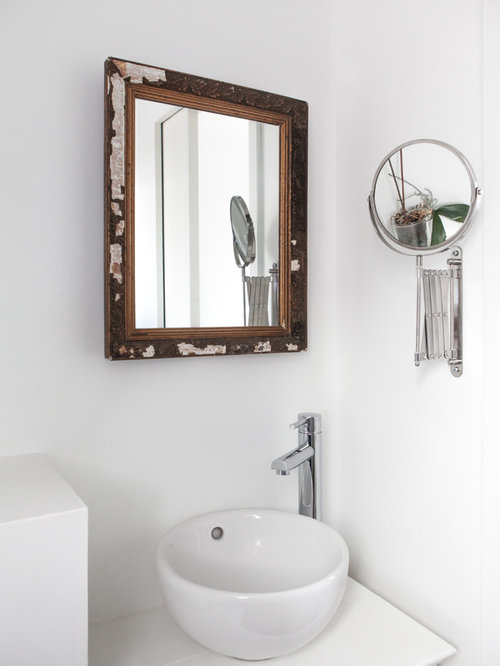 example of a small trendy bathroom design in paris with a vessel sink white walls