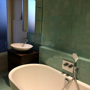 Photo of a mid-sized shabby-chic style kids bathroom in Paris with a drop-in tub, green tile, terra-cotta tile, terra-cotta floors and pink floor.