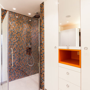 Design ideas for a midcentury shower room bathroom in Bordeaux with white cabinets, a built-in shower, a two-piece toilet, grey tiles, black tiles, orange tiles, mosaic tiles and white walls.