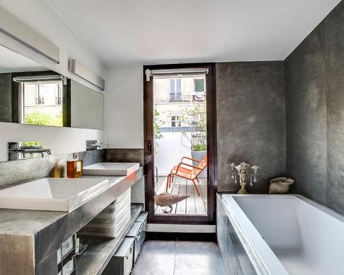 ide de dcoration pour une salle de bain design de taille moyenne avec un mur gris