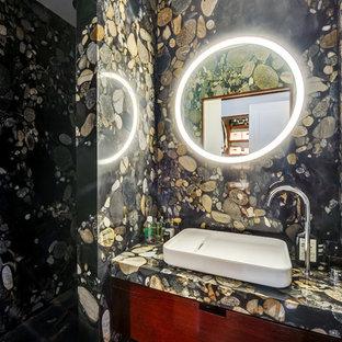 Inspiration pour une petite salle de bain design avec un placard à porte plane, un mur multicolore, une vasque et des portes de placard en bois sombre.