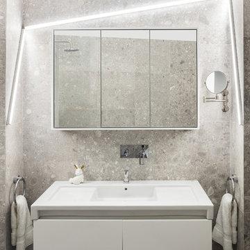 Une salle de bain contemporaine dans un appartement dans le XIV