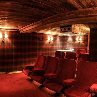 Mid-sized mountain style enclosed carpeted home theater photo in Grenoble with multicolored walls and a projector screen