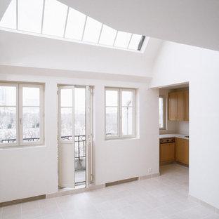 Inspiration pour une grande salle de séjour mansardée ou avec mezzanine design avec un mur blanc, un sol en carrelage de céramique et un sol rose.