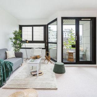 Inspiration pour une salle de séjour design ouverte avec un mur blanc, moquette et un sol beige.