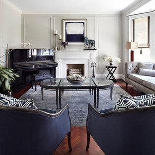 Réalisation d'une salle de séjour tradition fermée et de taille moyenne avec une salle de musique, un sol en bois foncé, une cheminée standard, aucun téléviseur, un mur gris et un manteau de cheminée en pierre.