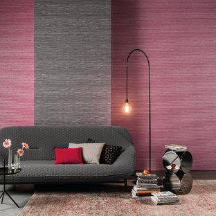 Ejemplo de sala de estar abierta, retro, de tamaño medio, sin chimenea y televisor, con paredes rosas y suelo de cemento
