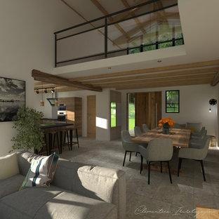 ボルドーの広いインダストリアルスタイルのおしゃれなロフトリビング (ゲームルーム、白い壁、セラミックタイルの床、両方向型暖炉、レンガの暖炉まわり、壁掛け型テレビ、グレーの床) の写真