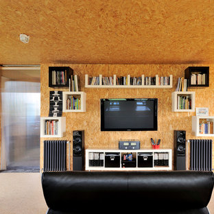 Inspiration for a mid-sized industrial loft-style plywood floor family room remodel in Lyon with beige walls, a wall-mounted tv and no fireplace