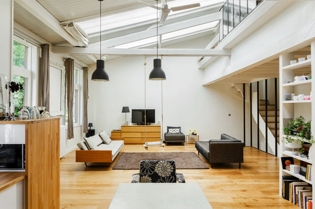 Industrial  Wohnzimmer by LE GROUPE 23