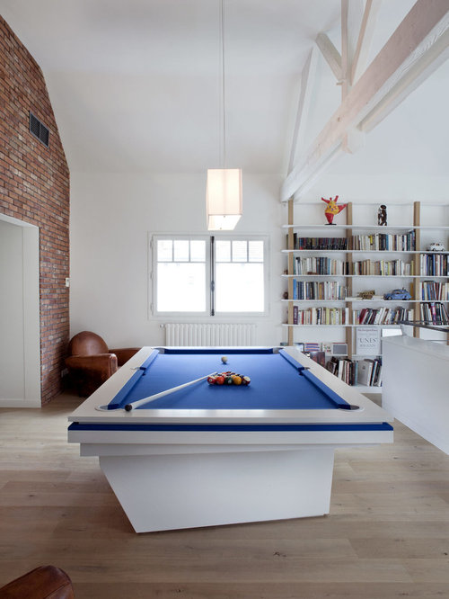 Inspiration For A Large Eclectic Medium Tone Wood Floor Game Room Remodel  In Paris With White