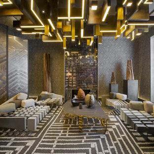 Cette image montre une salle de séjour design de taille moyenne et fermée avec un mur gris, moquette et aucun téléviseur.