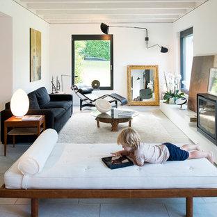 Idées déco pour une grande salle de séjour avec une bibliothèque ou un coin lecture contemporaine ouverte avec un mur blanc, un sol en carrelage de céramique et aucun téléviseur.