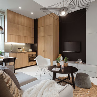 Inspiration pour une salle de séjour nordique ouverte avec un mur noir, aucune cheminée, un téléviseur fixé au mur et un sol blanc.